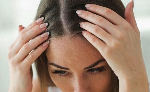 Women checking scalp